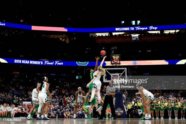 Ruthy Hebard of the Oregon Ducks and Lauren Cox of the Baylor Lady Bears battle for the opening tipoff during the first quarter in the semifinals of...