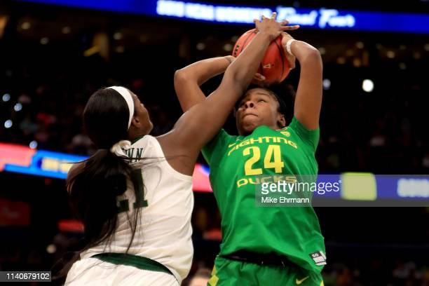 Ruthy Hebard of the Oregon Ducks has her shot blocked by Kalani Brown of the Baylor Lady Bears during the first half in the semifinals of the 2019...