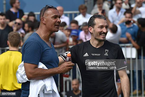 Ruud Gullit and Gianluca Zambrotta of AC Milan Inter Legends looks on during the Ultimate Champions Match between Milan Inter Legends and World...