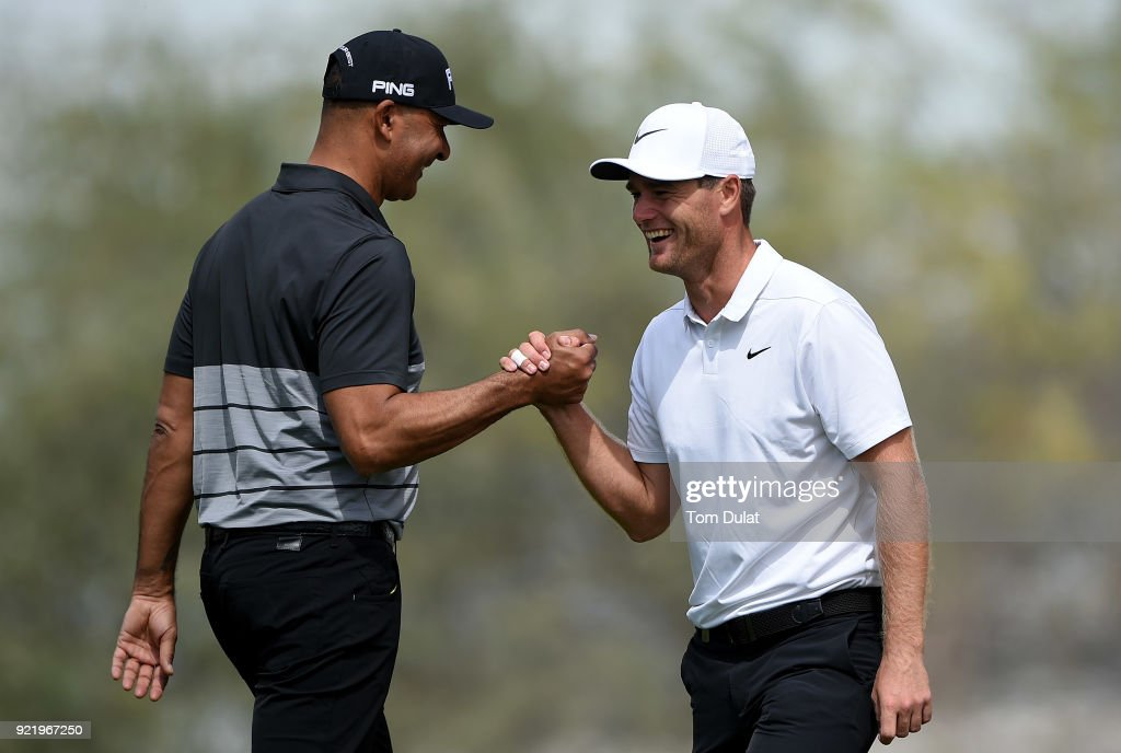 Ruud Gullit and Lucas Bjerregaard shake hands prior to the Commercial Bank Qatar Masters at Doha Golf Club on February 21, 2018 in Doha, Qatar.