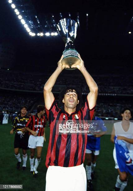 Ruud Gullit of AC Milan lift the trophy after winnings the Supercoppa italiana 1994 match between AC Milan and Sampdoria at Stadio Giuseppe Meazza on...