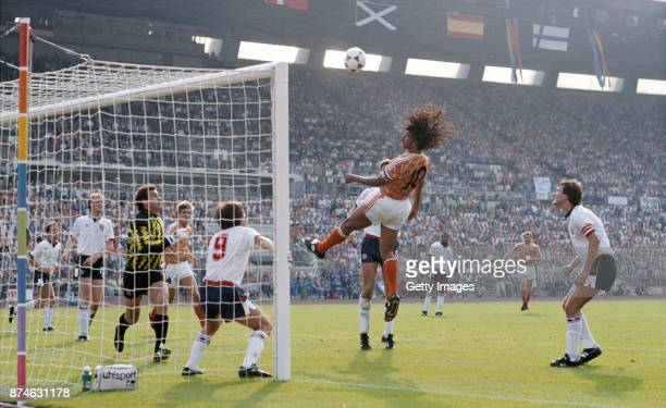 Ruud Gullit of Holland heads towards goal watched by Peter Shilton Peter Beardsley and Bryan Robson during the European Championship match against...