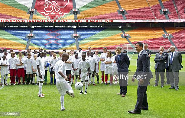 Ruud Gullit of the HollandBelgium Bid and Harold MyneNicholls leader of the FIFAcommission watch children played soccer in the Amsterdam Arena on...