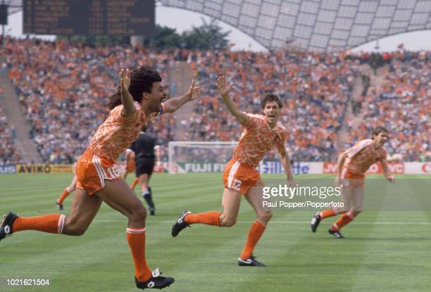 Ruud Gullit of the Netherlands celebrates after scoring with teammate Marco van Basten during the UEFA Euro 88 Final between the Soviet Union and the...