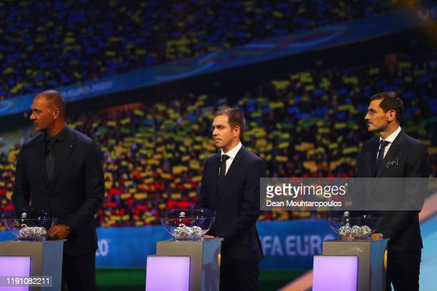 Ruud Gullit Philipp Lahm and Iker Casillas look on as they stand on stage during the UEFA Euro 2020 Final Draw Ceremony at the Romexpo on November 30...