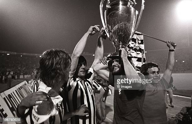 Ruud Krol Barry Hulshoff John Rep celebrate with the cup after winning the European Cup final match between Ajax and Juventus at the Red Star Stadium...
