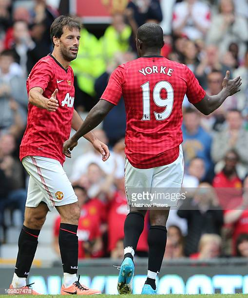 Ruud van Nistelrooy and Dwight Yorke of Manchester United celebrate the equaliser during the MU Foundation Charity Legends match between Manchester...