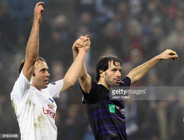 Ruud van Nistelrooy and Joris Mathijsen of Hamburg celebrate after the UEFA Europa League round of 16 first leg match between Hamburger SV and RSC...