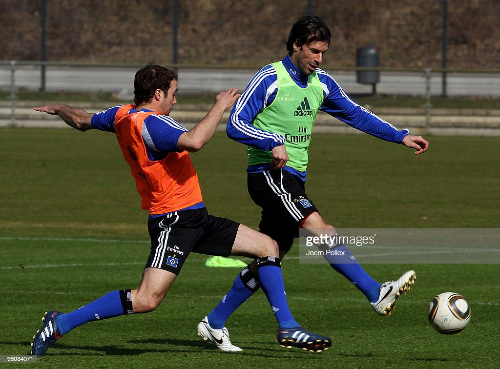 Ruud van Nistelrooy and Joris Mathijsen of Hamburg compete for the ball during the Hamburger SV training session at the HSH Nordbank Arena on March 25, 2010 in Hamburg, Germany.