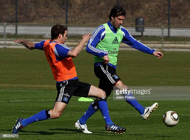 Ruud van Nistelrooy and Joris Mathijsen of Hamburg compete for the ball during the Hamburger SV training session at the HSH Nordbank Arena on March...