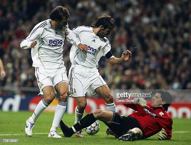 Ruud van Nistelrooy and Raul Gonzalez of Real Madrid try to get past Gregory Coupet of Lyon during the UEFA Champions League Group E match between...