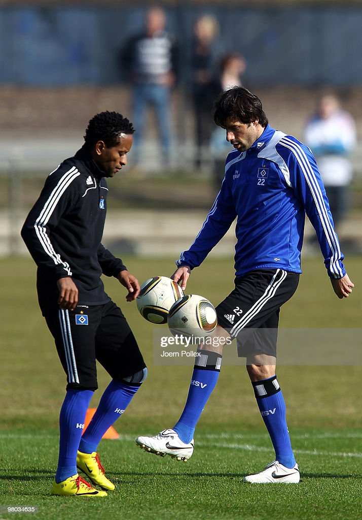Ruud van Nistelrooy and Ze Roberto (L) of Hamburg control the ball during the Hamburger SV training session at the HSH Nordbank Arena on March 25, 2010 in Hamburg, Germany.