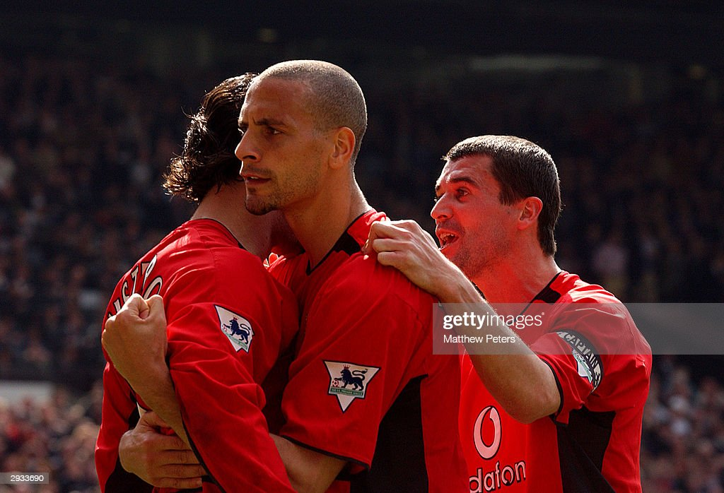 Ruud van Nistelrooy (left) celebrates his second goal with teammates Rio Ferdinand and Roy Keane during the FA Barclaycard Premiership match between Manchester United v Liverpool at Old Trafford on April 5, 2003 in Manchester, England.