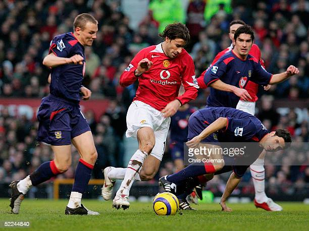 Ruud van Nistelrooy clashes with Matthew Taylor of Portsmouth during the Barclays Premiership match between Manchester United and Portsmouth at Old...