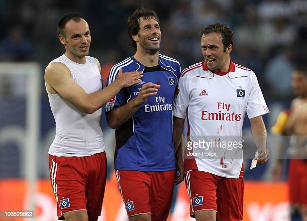 Ruud van Nistelrooy Heiko Westermann and Joris Mathijsen of Hamburg celebrate after the Bundesliga match between Hamburger SV and FC Schalke 04 at...