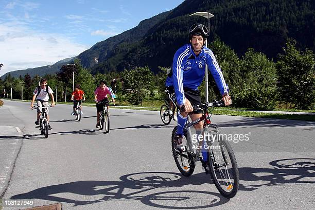 Ruud van Nistelrooy is followed by young supporters as he rides his bicycle during the pre-season training camp of Hamburger SV at the Aqua Dome...
