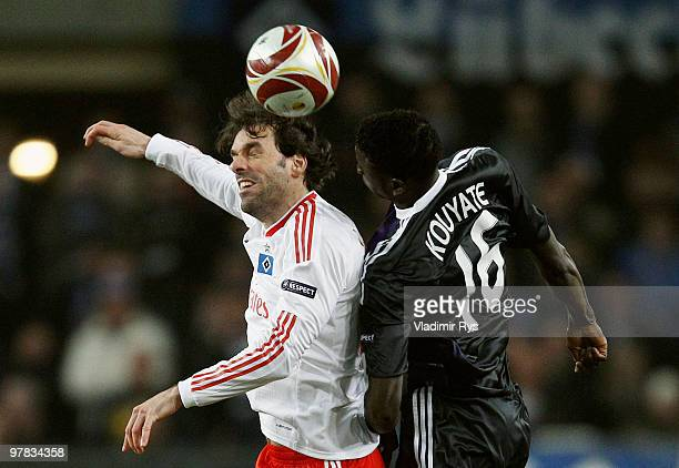 Ruud van Nistelrooy of Hamburg and Cheikhou Kouyate of Anderlecht go up for a header during the UEFA Europa League round of 16 second leg match...