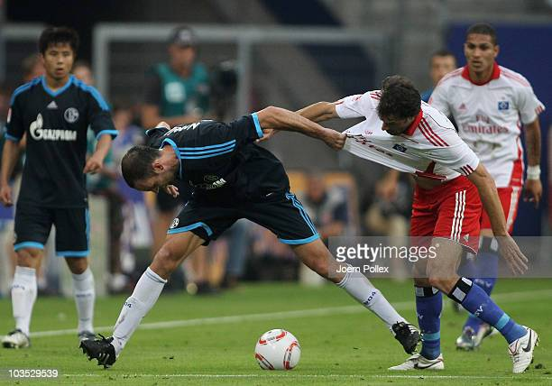 Ruud van Nistelrooy of Hamburg and Christoph Metzelder of Schalke battle for the ball during the Bundesliga match between Hamburger SV and FC Schalke...
