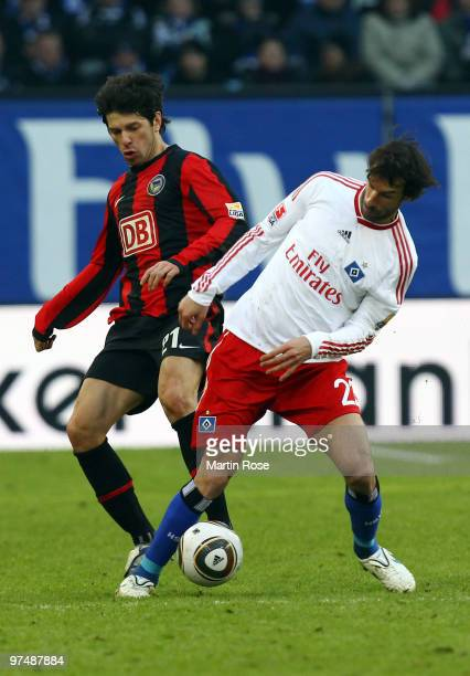 Ruud van Nistelrooy of Hamburg and Levan Kobiashvili of Berlin compete for the ball during the Bundesliga match between Hamburger SV and Hertha BSC...