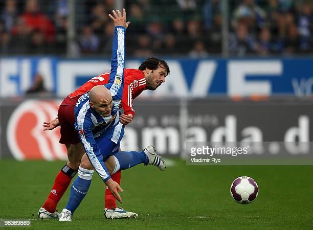 Ruud van Nistelrooy of Hamburg and Milos Maric of Bochum battle for the ball during the Bundesliga match between VfL Bochum and Hamburger SV at...