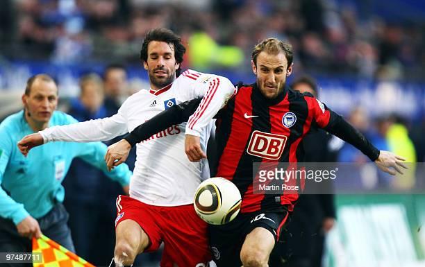 Ruud van Nistelrooy of Hamburg and Roman Hubnik of Berlin compete for the ball during the Bundesliga match between Hamburger SV and Hertha BSC Berlin...