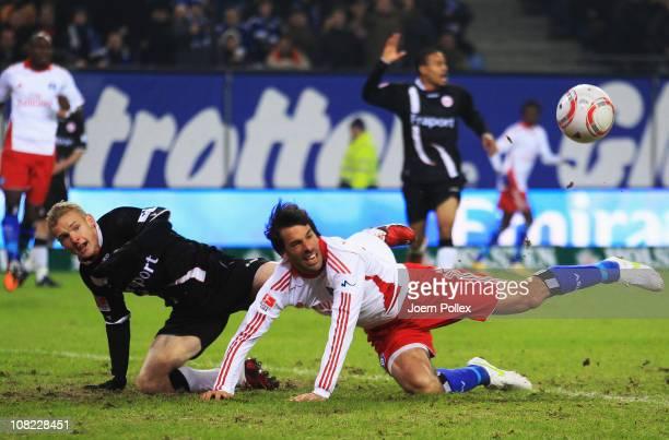 Ruud van Nistelrooy of Hamburg and Sebastian Rode of Frankfurt battle for the ball during the Bundesliga match between Hamburger SV and Eintracht...