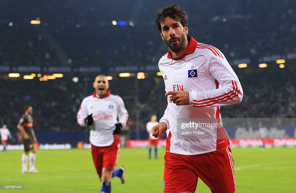 Ruud van Nistelrooy (R) of Hamburg celebrates after scoring his team's fourth goal during the Bundesliga match between Hamburger SV and VfB Stuttgart at Imtech Arena on November 27, 2010 in Hamburg, Germany.