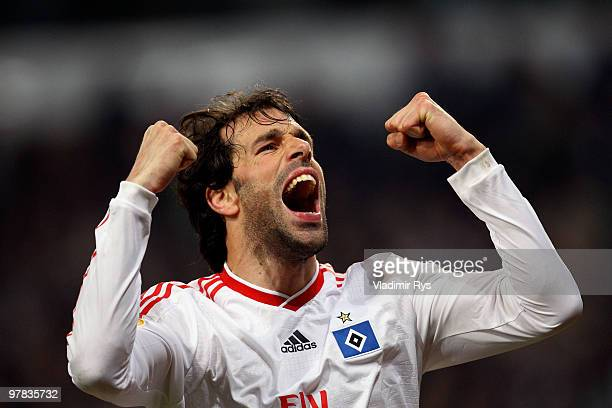 Ruud van Nistelrooy of Hamburg celebrates his team's third goal scored by his team mate Mladen Petric during the UEFA Europa League round of 16...