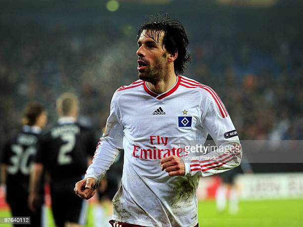 Ruud van Nistelrooy of Hamburg celebrates scoring his teams second goal during the UEFA Europa League round of 16 first leg match between Hamburger...