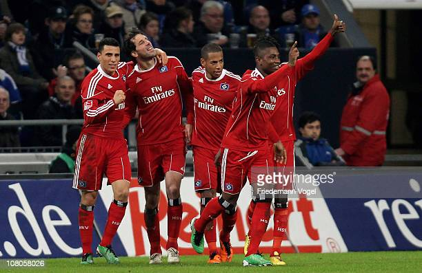 Ruud van Nistelrooy of Hamburg celebrates scoring the first goal with his team during the Bundesliga match between FC Schalke 04 and Hamburger SV at...