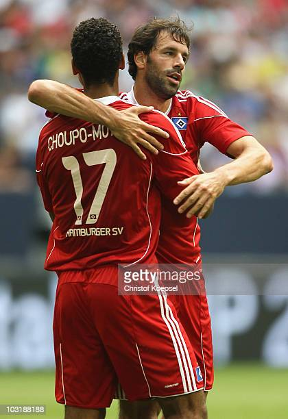 Ruud van Nistelrooy of Hamburg celebrates the first goal with EricMaxim ChoupoMoting during the LIGA total Cup 2010 third place playoff match between...
