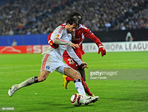 Ruud van Nistelrooy of Hamburg is challenged by Eliaquim Mangala of Liege during the UEFA Europa League quarter final first leg match between...