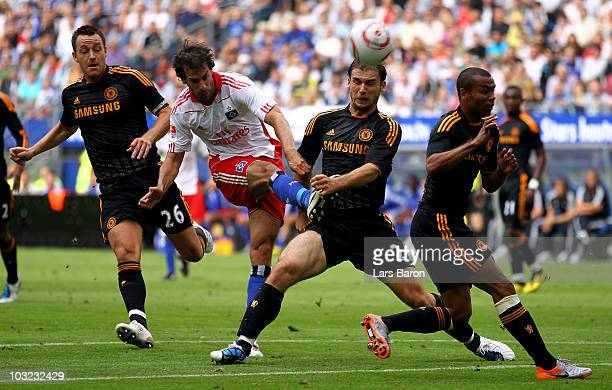 Ruud van Nistelrooy of Hamburg is challenged by Frank Lampard Branislav Ivanovic and Ashley Cole of Chelsea during a pre season friendly match...