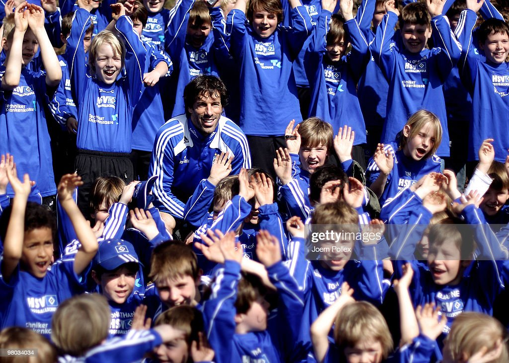 Ruud van Nistelrooy of Hamburg is pictured with fans after the Hamburger SV training session at the HSH Nordbank Arena on March 25, 2010 in Hamburg, Germany.