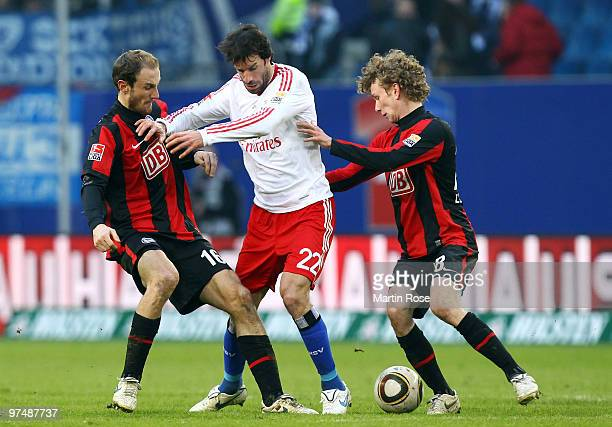 Ruud van Nistelrooy of Hamburg, Roman Hubnik and Fabian Lustenberger of Berlin compete for the ball during the Bundesliga match between Hamburger SV...