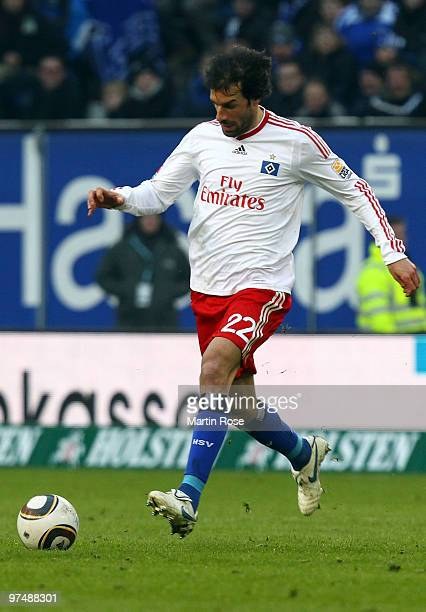 Ruud van Nistelrooy of Hamburg runs with the ball during the Bundesliga match between Hamburger SV and Hertha BSC Berlin at HSH Nordbank Arena on...