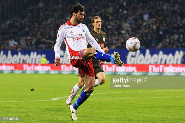 Ruud van Nistelrooy of Hamburg scores his team's fourth goal during the Bundesliga match between Hamburger SV and VfB Stuttgart at Imtech Arena on...