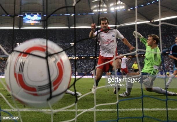 Ruud van Nistelrooy of Hamburg scores his team's second goal during the Bundesliga match between Hamburger SV and FC Schalke 04 at Imtech Arena on...