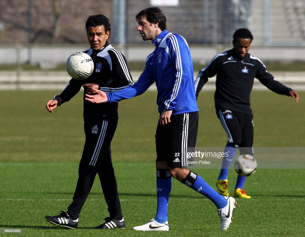 Ruud van Nistelrooy (C) of Hamburg talks to assistent coach Ricardo Moniz during the Hamburger SV training session at the HSH Nordbank Arena on March 25, 2010 in Hamburg, Germany.