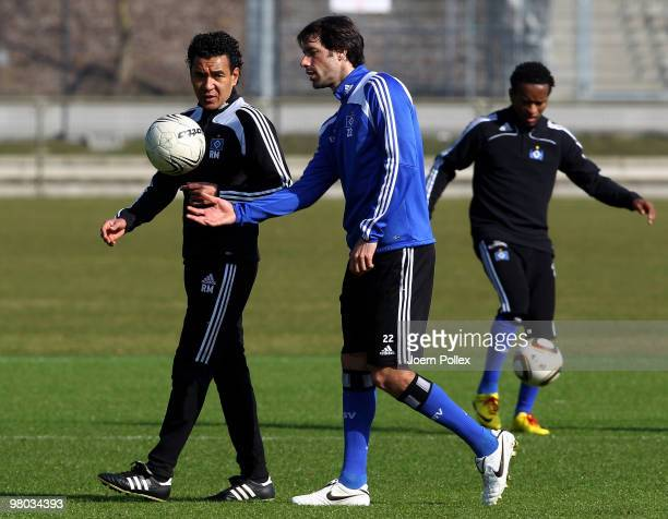 Ruud van Nistelrooy of Hamburg talks to assistent coach Ricardo Moniz during the Hamburger SV training session at the HSH Nordbank Arena on March 25...