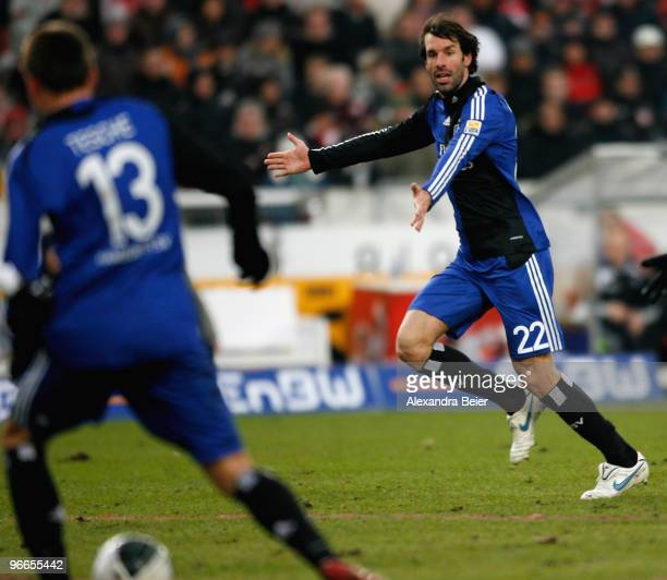 Ruud van Nistelrooy of Hamburger SV gestures to teammate Robert Tesche before he scores his second goal during the Bundesliga first division soccer...