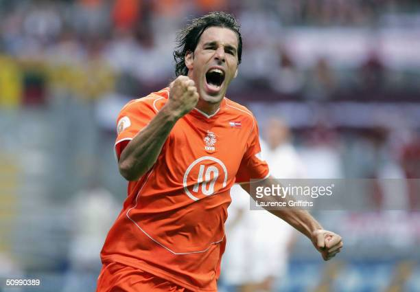 Ruud Van Nistelrooy of Holland celebrates after scoring the first goal during the UEFA Euro 2004 Group D match between Holland and Latvia at the...