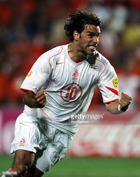 Ruud Van Nistelrooy of Holland celebrates scoring his penalty during the UEFA Euro 2004 Quarter Final match between Sweden and Holland at the Algarve...