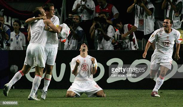 Ruud Van Nistelrooy of Holland drops to his knees to celebrate after holland win on penaltys during the UEFA Euro 2004 Quarter Final match between...