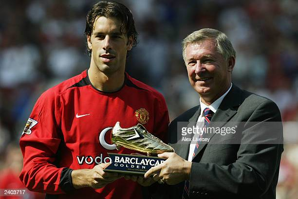 Ruud Van Nistelrooy of Man Utd is presented with the Barclaycard golden boot for last season by Sir Alex Ferguson during the FA Barclaycard...
