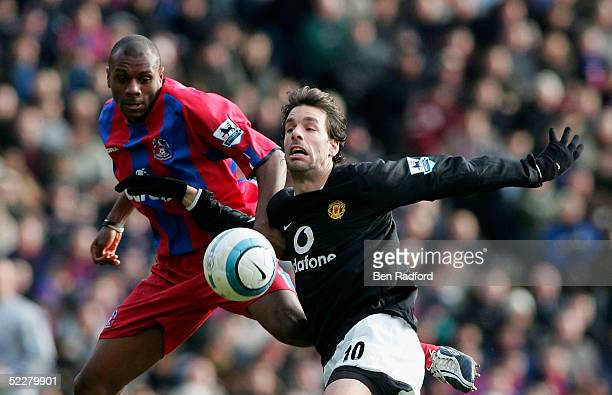 Ruud Van Nistelrooy of Manchester United and Emerson Boyce of Crystal Palace challenge for the ball during the Barclaycard Premiership match between...