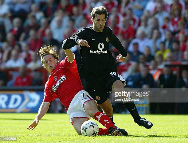 Ruud Van Nistelrooy of Manchester United battles for the ball with Scott Parker of Charlton Athletic during the FA Barclaycard Premiership match...
