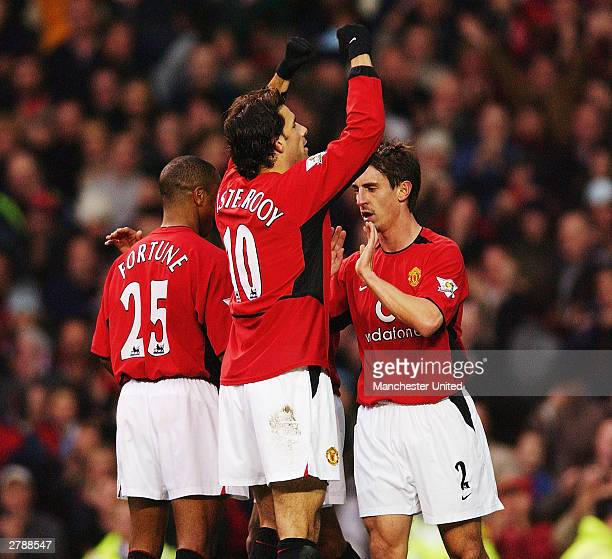 Ruud van Nistelrooy of Manchester United celebrates scoring the opening goal against Aston Villa with Quinton Fortune and Gary Neville during the FA...