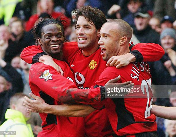 Ruud van Nistelrooy of Manchester United celebrates scoring the second goal, his 100th for United, with Louis Saha and Mikael Silvestre during the FA...