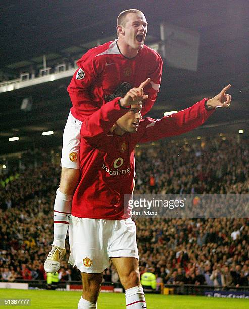Ruud van Nistelrooy of Manchester United celebrates scoring the seventh goal of the game with Wayne Rooney during the UEFA Champions League match...